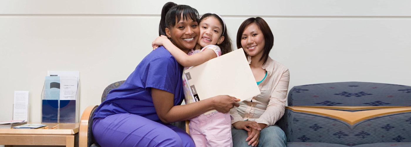 pediatric hugging her patient